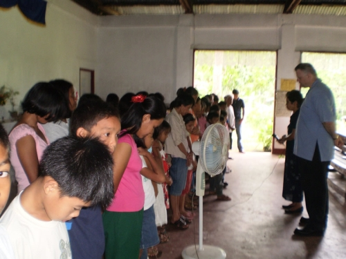 Pastor Paul and Pastor Nena pray for new believers in Guimaras