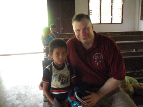 Pastor Paul with one of the Sponsor-A-Child boys